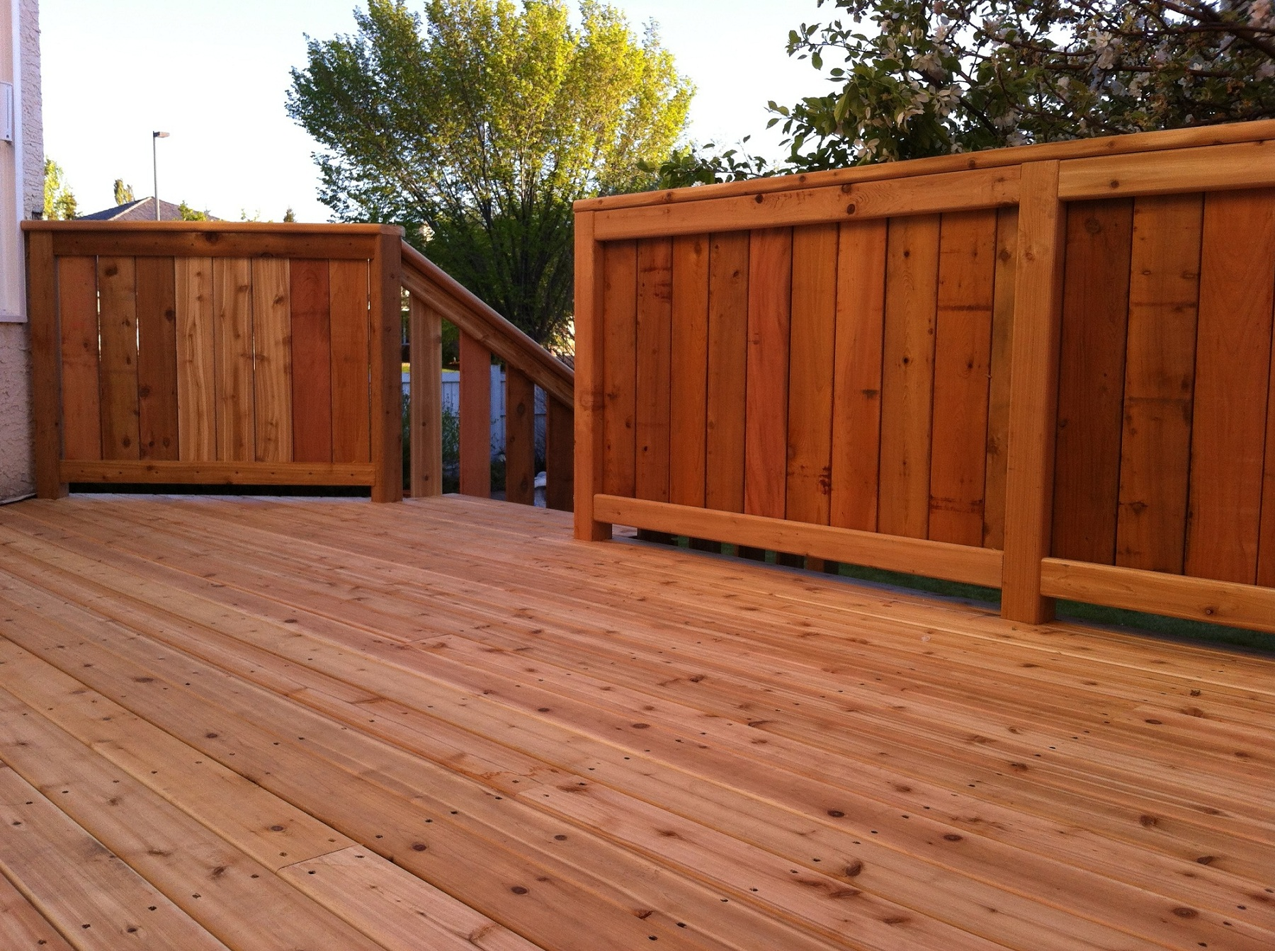stained cedar deck with fenced railing deckrative designs ltd