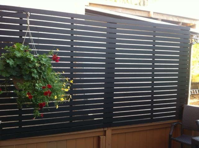 Calgary deck privacy with hanging flowers deckrative for Hanging privacy screens for decks
